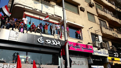 Protestors on rooftops demonstrate in Cairo, Egypt Stock Video Footage