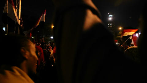 Protestors demonstrate at a nighttime rally in Cai Stock Video Footage