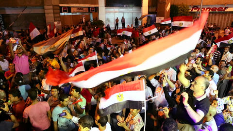 Crowds protest at a nighttime rally in Tahrir Squa Stock Video Footage