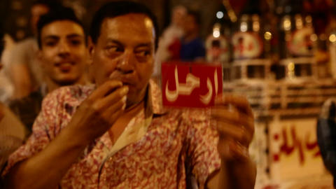 A protestor blows a whistle at a rally in Cairo, E Stock Video Footage