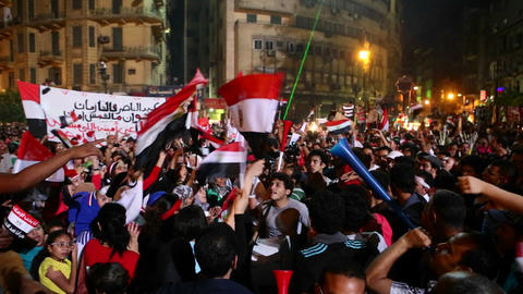 Protestors chant at a nighttime rally in Tahrir Sq Footage