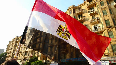The sun shines through a protestor's flag in Cairo Stock Video Footage