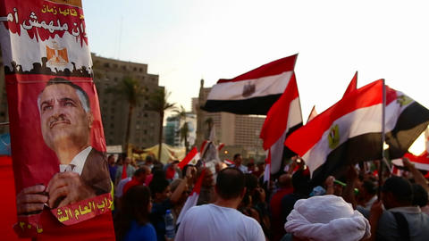Crowds gather in Tahrir Square in Cairo, Egypt Stock Video Footage