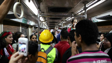 Protestors chant while aboard a metro in Cairo, Eg Footage