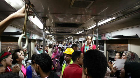 Protestors chant while aboard a metro in Cairo, Eg Stock Video Footage
