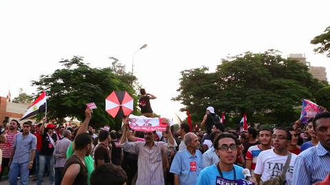 Protestors march and chant in Cairo, Egypt Stock Video Footage