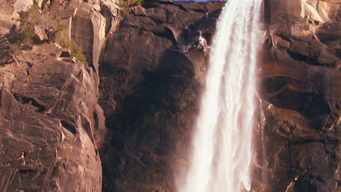 Tilt down to follow water flowing from s a beautif Stock Video Footage