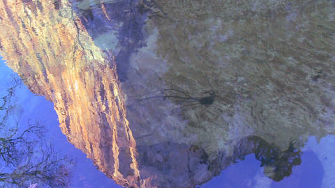 El Capitan is reflected in the Merced River in Yos Footage