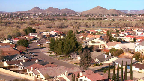 Birds eye view over neighborhoods and suburban spr Stock Video Footage