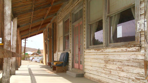 The facade of an old bar or diner sits in the Moja Stock Video Footage