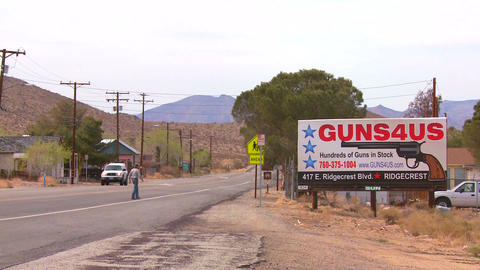 Guns are sold along a desert highway in America Stock Video Footage