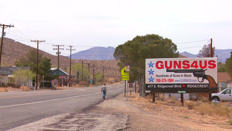 Guns are sold along a desert highway in America Footage