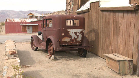 An old car sits in the ghost town of Garlock, Cali Stock Video Footage