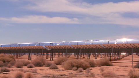 Pan across a solar farm in the desert generates el Footage