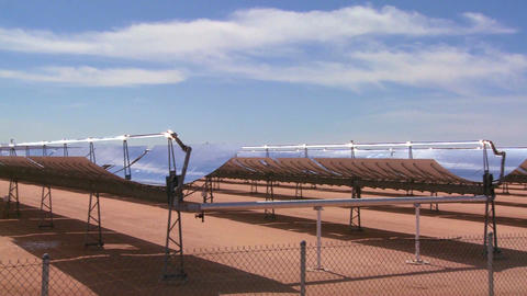 Pan across a solar farm in the desert generates el Live Action