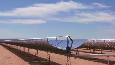 Time lapse of clouds over a solar generating farm  Footage
