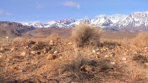 Pan across the snowcapped Sierra Nevada mountains Stock Video Footage