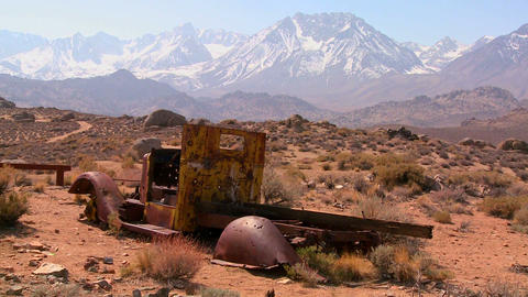 Abandoned pickup truck with the snowcapped Sierra Stock Video Footage