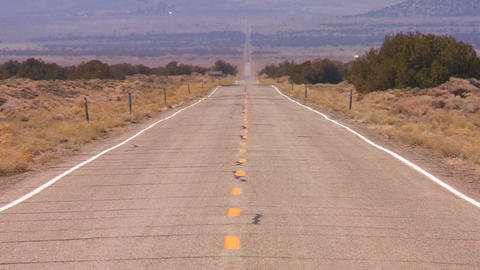 Heat rises from a long straight lonely road in the Stock Video Footage