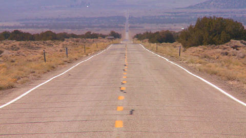 Heat rises from a long straight lonely road in the Footage