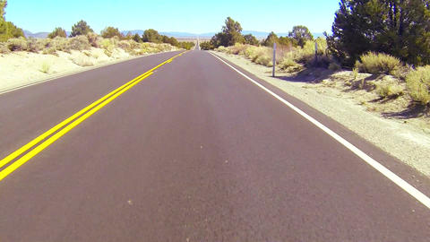 POV shot along a desert road driving fast Stock Video Footage