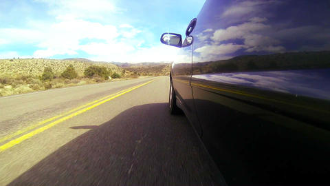 POV shot driving along a desert road at a fast spe Footage