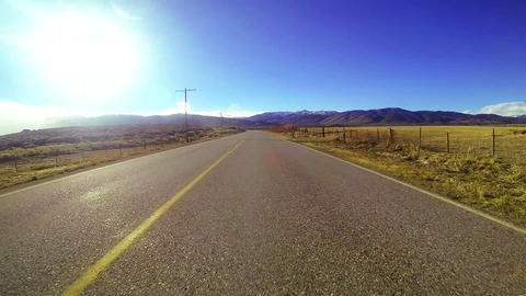 POV shot driving along a country road at a very fa Stock Video Footage