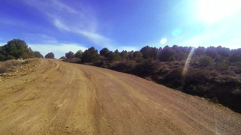 POV shot driving along a dirt road Stock Video Footage