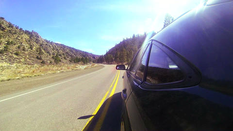 POV shot driving fast along a mountain road with t Stock Video Footage