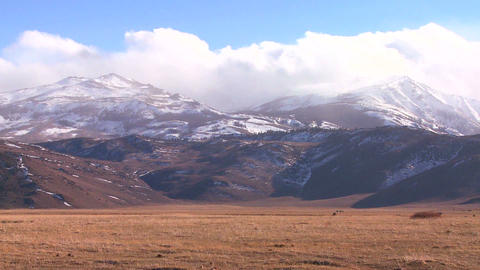 Clouds gather in the Sierra mountain range Stock Video Footage