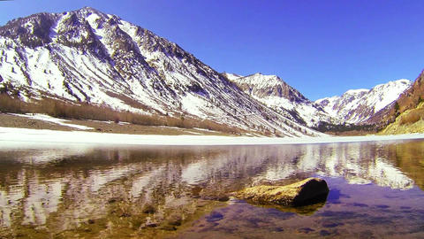 The camera moves across the water of a beautiful a Footage
