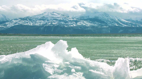 Ice forms on the shore of a beautiful mountain lak Stock Video Footage
