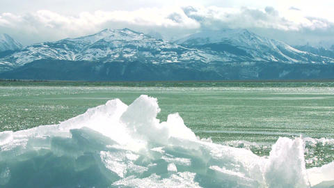 Ice forms on the shore of a beautiful mountain lak Footage