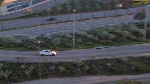Zoom back from cars arriving at LAX to airport est Stock Video Footage
