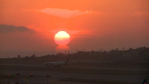 A plane arrives at an airport at sunset or sunrise Stock Video Footage