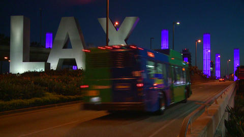 Cars pass by the LAX sign on their way into Los An Stock Video Footage