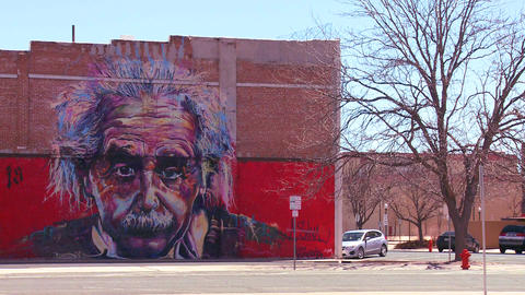 A mural of Albert Einstein is painted on a buildin Stock Video Footage