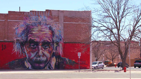 A mural of Albert Einstein is painted on a buildin Footage
