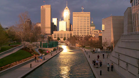 Indianapolis Indiana river walk at dusk with sun g Stock Video Footage