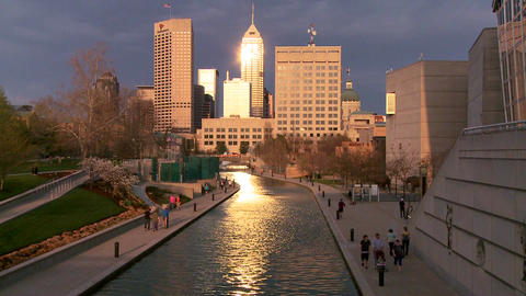 Indianapolis Indiana river walk at dusk with sun g Footage