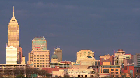 The skyline of the city of Indianapolis at dusk Footage