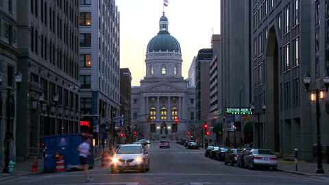 Traffic passes the downtown capital building in In Footage