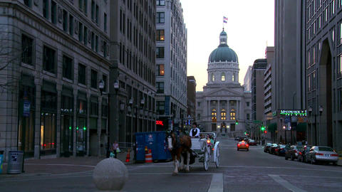 A horse drawn carriage passes the downtown capital Stock Video Footage