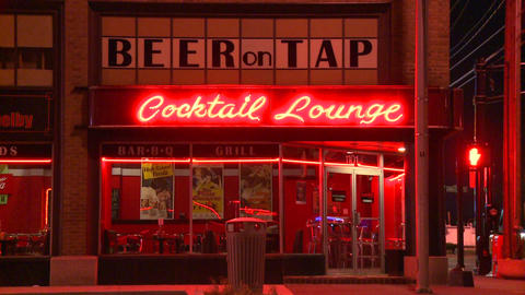 A neighborhood corner cocktail lounge at night Stock Video Footage