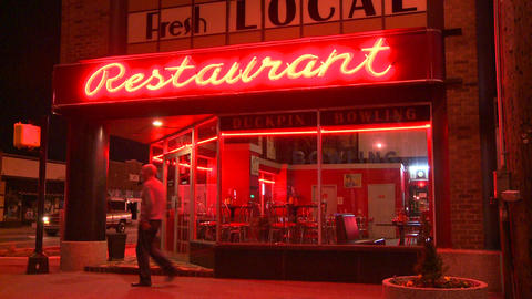 A neighborhood corner restaurant at night Footage