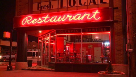 A neighborhood corner restaurant at night Stock Video Footage