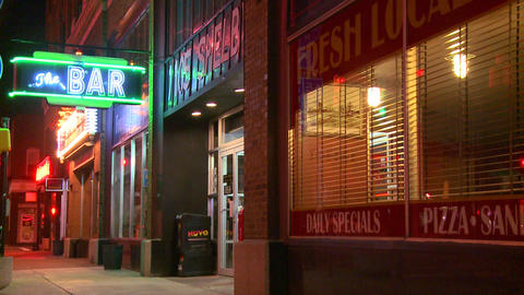 An empty city street with a neon bar sign Stock Video Footage