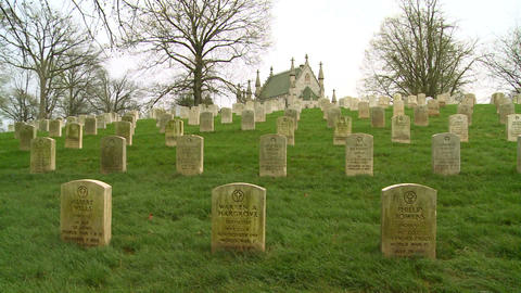 A 19th century cemetery is framed by a church on a Footage