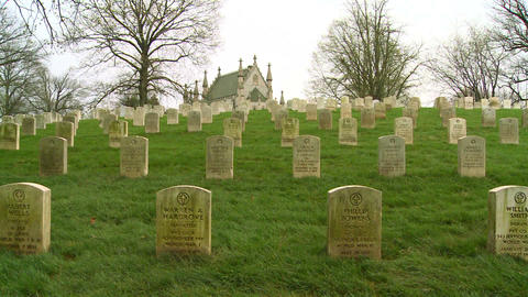 A 19th century cemetery is framed by a church on a Stock Video Footage