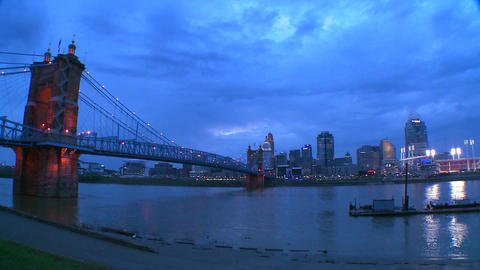 Pan across the Ohio River as night falls on Cincin Stock Video Footage